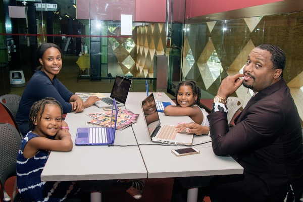 "Frank and Allene Bryant, seen here with their daughters Franki, 6, and Elle, 4, are the creators of the ""Learning with GoGo"" book series. (Shevry Lassiter/The Washington Informer)"