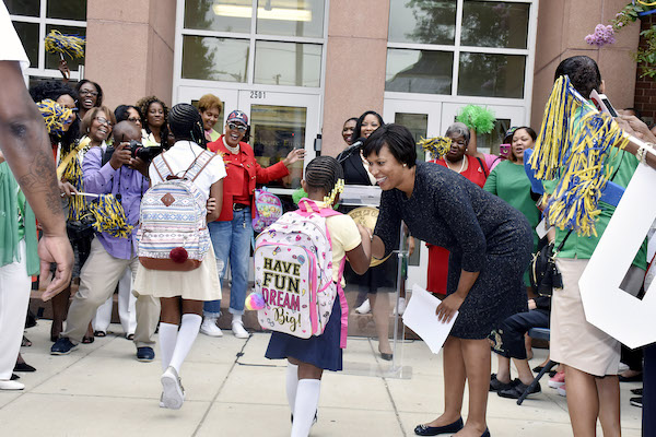 D.C. Mayor Muriel Bowser greets students at Excel Academy in Southeast, the city's first all-girl public school, on Aug. 20, the first day of the 2018-2019 traditional school year. (Robert Roberts/The Washington Informer)