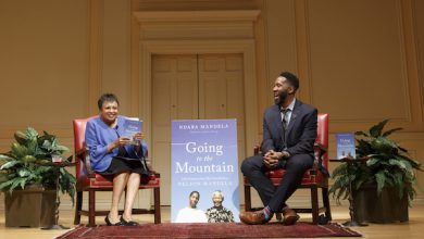 """Librarian of Congress Carla Hayden speaks with Ndaba Mandela, author of """"Going to the Mountain: Life Lessons from My Grandfather, Nelson Mandela,"""" on June 27. (Shawn Miller/Library of Congress)"""