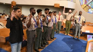 Court of Honor inductees (beginning second from left) Elmer Douglas Ellis Jr., James Omar Dorman, Ian Hunter Groom, Campbell James Wilson and Columbus Jared Giles take the Scout oath with other Eagle Scouts and Scout leaders at Peoples Congregational UCC Church in northwest D.C. on July 21. (Roy Lewis/The Washington Informer)