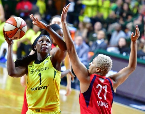Seattle Storm forward Crystal Langhorne attempts a shot over the outstretched arm of Washington Mystics forward Tianna Hawkins during the Storm's 98-82 win in Game 3 of WNBA Finals at Eagle Bank Arena at George Mason University on Sept. 12. (John De Freitas/The Washington Informer)