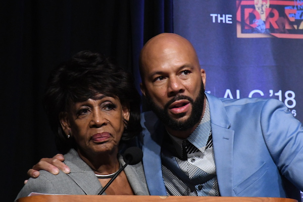Rep. Maxine Waters (left) stands with rapper Common during a panel discussion on the performance arts in Black culture during the Congressional Black Caucus Foundation's 48th Annual Legislative Conference at the Walter E. Washington Convention Center in D.C. on Sept. 14. (Roy Lewis/The Washington Informer)