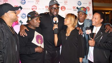 """Michel Wright, Ferman Patterson, Gregory """"Sugar Bear"""" Eliot, Anwan """"Big G"""" Glover and the members of EU at the historic Lincoln Theatre on Sept. 9 for the premiere of """"Straight Crankin'."""" (Brigette Squire/The Washington Informer)"""