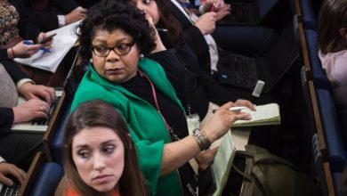 **FILE** April Ryan, center top, reporter at American Urban Radio Networks, listens during the daily briefing in the Brady Press Briefing Room of the White House in Washington, DC on Tuesday, Feb. 14, 2017. (Photo by Jabin Botsford/The Washington Post via Getty Images)