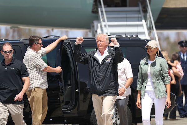 President Donald Trump and Melania Trump arrive on Air Force One at the Muniz Air National Guard Base in in Carolina, Puerto Rico. for a visit on Oct. 3, 2017, after Hurricane Maria hit the island. (Joe Raedle/Getty Images)