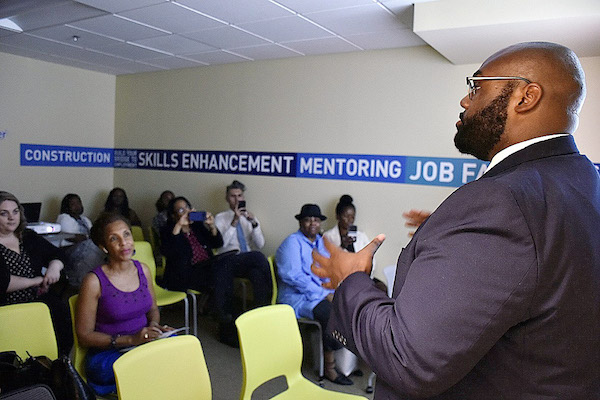 Walter L. Simmons (right), president and CEO of Employ Prince George's, talks about a new program geared toward residents ages 18 to 24 at the county's Youth Career Center in Suitland, Maryland, on Aug. 29. (Robert Roberts/The Washington Informer)