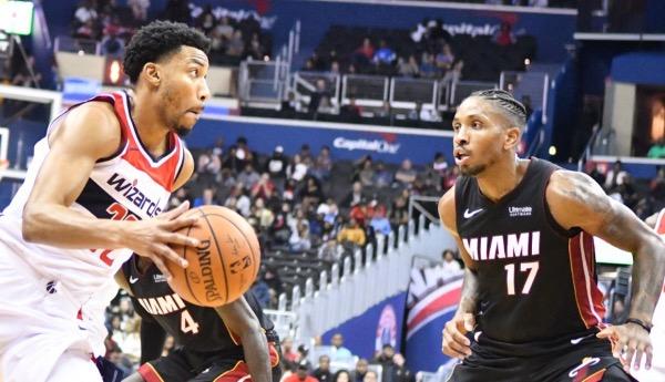 Washington Wizards forward Otto Porter Jr. drives against Miami Heat guard Rodney McGruder during the Wizards' 121-114 preseason win at Capital One Arena in D.C. on Oct. 5. (John De Freitas/The Washington Informer)