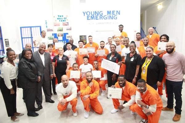 The ceremony for the Young Men Emerging (Y-ME) Unit brought smiles and positive energy to the graduates and the Industrial bank and DC DOC personnel who attended. (Courtesy of DC Department of Corrections)