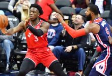 Toronto Raptors forward OG Anunoby catches a pass while defended by Washington Wizards forward Markieff Morris during the Raptors' 117-113 win at Capital One Arena in D.C. on Oct. 20. (John E. De Freitas/The Washington Informer)