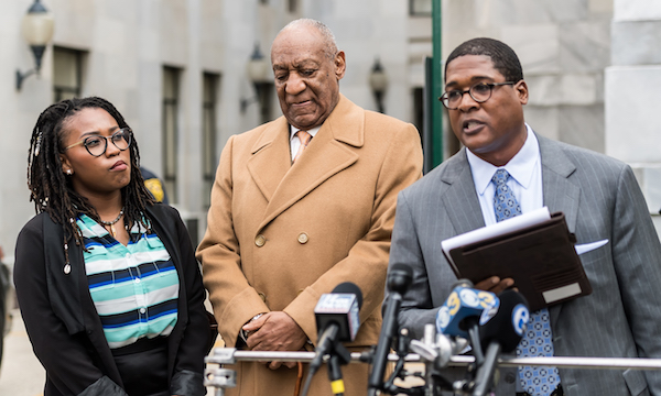 Actor/ stand-up comedian Bill Cosby (C) and his publicists Ebonee Benson (L) and Andrew Wyatt (R) speak to the press at the Montgomery County Courthouse during the fourth day of his retrial for sexual assault charges on April 12, 2018 in Norristown, Pennsylvania. A former Temple University employee alleges that the entertainer drugged and molested her in 2004 at his home in suburban Philadelphia. More than 40 women have accused the 80 year old entertainer of sexual assault. (Photo by Gilbert Carrasquillo/Getty Images)