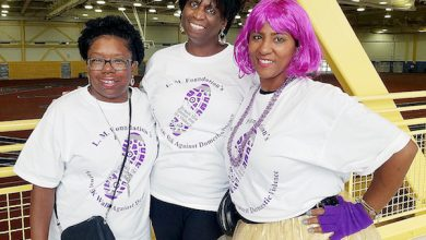 Pamela Price (center) runs L.M. Foundation of Temple Hills, which organized an Oct. 6 domestic violence walk at the Wayne K. Curry Sports and Learning Complex. Wanda Washington (left) and Tomika Douglas, two domestic violence survivors, participate in the walk. (William J. Ford/The Washington Informer)