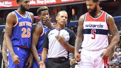 Referee Eric Lewis steps in between Washington Wizards forward Markieff Morris (5) and New York Knicks center Mitchell Robinson after a verbal altercation in the second quarter of the Knicks' 124-121 preseason win at Capital One Arena in D.C. on Oct. 1. (John De Freitas/The Washington Informer)