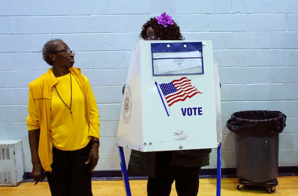 **FILE** A voter asks an election worker a question as she votes at Samuels Community Center in the presidential election in the Harlem neighborhood of New York City on Nov. 8, 2016. (Kena Betancur/AFP/Getty Images)