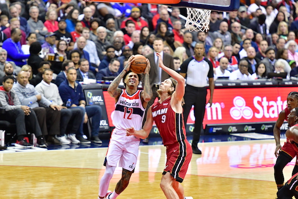 Washington Wizards forward Kelly Oubre Jr. drives against Miami Heat center Kelly Olynyk during the Heat's 113-112 win at Capital One Arena in D.C. on Oct, 18. (John E. De Freitas/The Washington Informer)