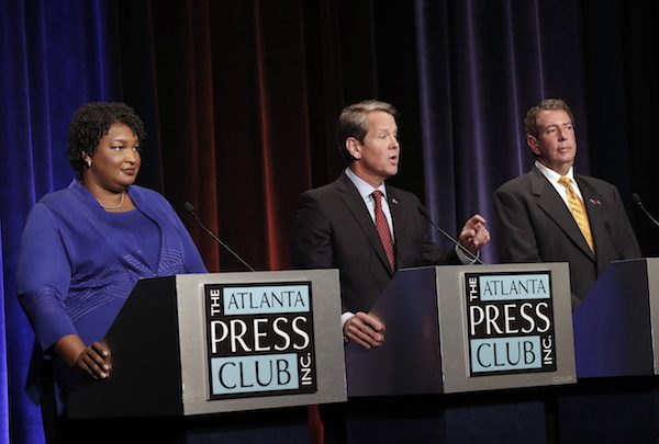 From left: Georgia gubernatorial candidates Democrat Stacey Abrams, Republican Brian Kemp and Libertarian Ted Metz debate at Georgia Public Broadcasting in Midtown October 23, 2018 in Atlanta, Georgia. (Photo by John Bazemore-Pool/Getty Images)