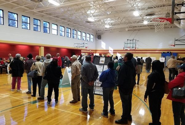 Dozens of Prince George's County residents line up at Upper Marlboro Community Center on Oct. 25, the first day of early voting for the Maryland general election. (William J. Ford/The Washington Informer)