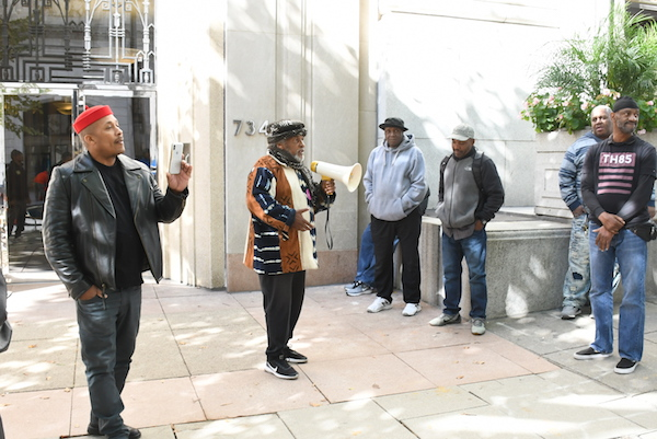 **FILE** Yango Sawyer uses a bullhorn to speak to returning citizens gathered for a protest at the City Paper headquarters in northwest D.C. on Oct. 16. (Roy Lewis/The Washington Informer)