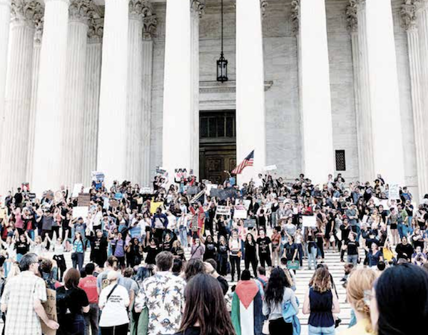 A large group of women take to the steps of the U.S Supreme Court in protest shortly after Brett Kavanaugh's confirmation was announced on Oct. 6. (Michael A. McCoy)