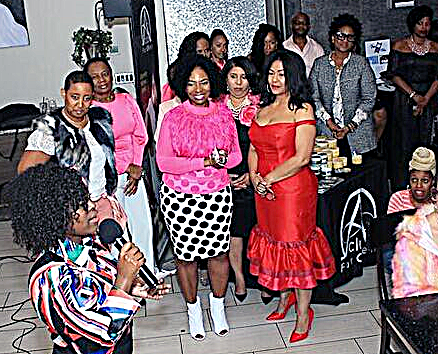 Tallulah Anderson (left) and Madelyne Woods observe as Shonte' Drakeford reflects on her life as a Stage IV cancer survivor. Anderson is founder of 2Boobs2, a nonprofit breast cancer awareness foundation. Woods served as fashion show MC for the Oct. 18 event. (Photo by John Wardell)