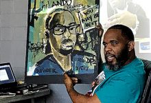 """Demont """"Picasso"""" Pinder, whose paintings often depict victims of violence throughout the country and the world, says his """"calling is using my God-given gift to bring a smile to the families that have gone through this tragic situation."""" (DR Barnes/The Washington Informer)"""