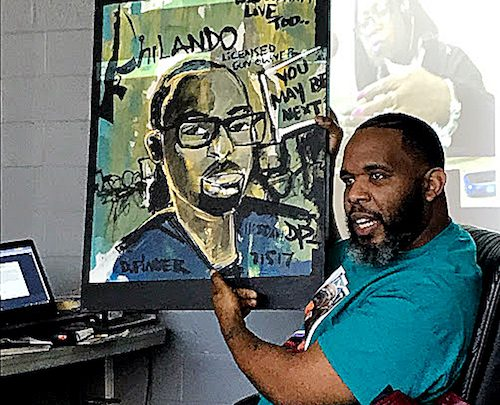 "Demont ""Picasso"" Pinder, whose paintings often depict victims of violence throughout the country and the world, says his ""calling is using my God-given gift to bring a smile to the families that have gone through this tragic situation."" (DR Barnes/The Washington Informer)"