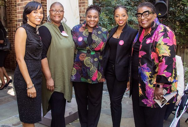 From left: Prince George's County Executive hopeful Angela Alsobrooks, Black Women's Roundtable President and CEO Melanie Campbell, D.C. Council Candidate Dionne Reeder, activist Tamika Mallory and Chief Executive Officer of the Recreation Wish List Committee Cora Masters Barry are a few of the women who attended a fundraiser in Northwest supporting Reeder. (Shevry Lassiter/The Washington Informer)