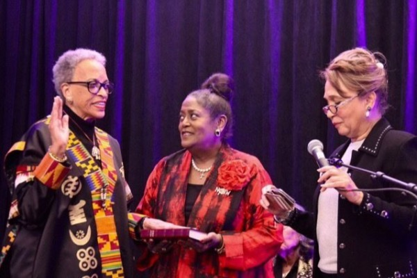 From left: Johnnetta Betsch Cole takes the oath of office as new chair and president of the National Council of Negro Women as Ingrid Saunders Jones holds Bible and former Secretary of Labor Alexis M. Herman, an adviser to NCNW, swears in Cole during the council's biennial convention at the Grand Hyatt Washington in D.C. on Nov. 11. (NCNW/Summerland)