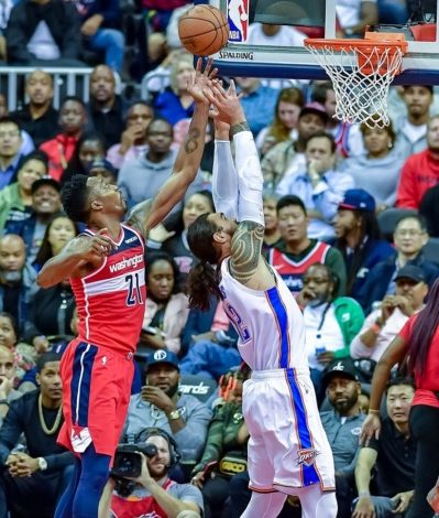 Washington Wizards center Dwight Howard (left) attempts to grab a rebound from Oklahoma City Thunder center Steven Adams during the Thunder's 134-111 win at Capital One Arena in D.C. on Nov. 2. (Yusuf Abdullah/The Washington Informer)