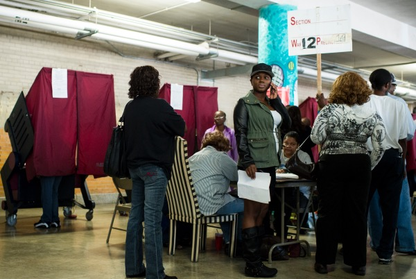 Voters wait for their turn in one of the voting booths at Eleanor McMain School in New Orleans on Election Day, Tuesday, Nov. 4, 2014. (Photo By Bill Clark/CQ Roll Call)