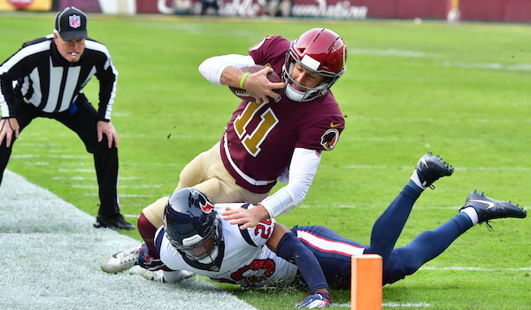 Washington Redskins quarterback Alex Smith is tackled near the goal line by Houston Texans safety Justin Reid during Houston's 23-21 win at FedEx Field in Landover, Md., on Sunday, Nov. 18. (John E. De Freitas/The Washington Informer)