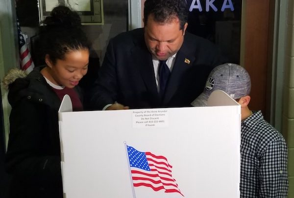 Maryland gubernatorial candidate Ben Jealous reviews a ballot with daughter Morgan and nephew Jaden Parrish at Lake Shore Elementary School in Pasadena on Nov. 6, Election Day. (William J. Ford/The Washington Informer)