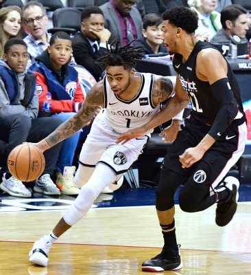Brooklyn Nets guard D'Angelo Russell (left) drives past Washington Wizards forward Otto Porter Jr. during the Nets' 115-104 win at Capital One Arena in D.C. on Nov. 16. (John E. De Freitas/The Washington Informer)