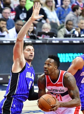 Washington Wizards center Dwight Howard (21) attempts to go up inside the paint against Orlando Magic center Nikola Vucevic (9) in the first quarter of the Wizards' 117-109 victory at Capital One Arena in D.C. on Nov. 12. (John De Freitas/The Washington Informer)