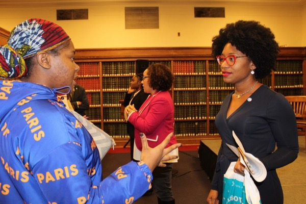 Howard University student Tobi Aderotoye (left) chats with Howard professor Keneshia Grant on Nov. 13 after a discussion on Black women and the 2018 midterms. The talk took place on the northwest D.C. campus. (Brigette White/The Washington Informer)