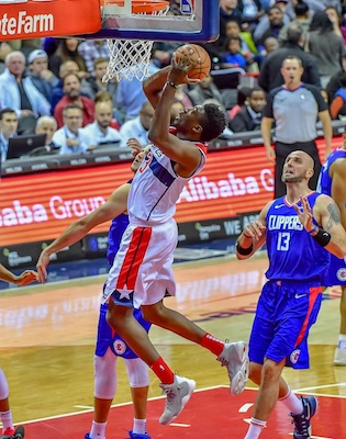 Washington Wizards center Thomas Bryant converts a layup in the first quarter of the Wizards' 125-118 win over the Los Angeles Clippers at Capital One Arena in D.C. on Nov. 20. (Yusuf Abdullah/The Washington Informer)