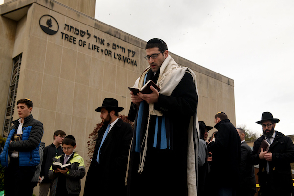 Members of the Jewish faith gather in front of the Tree of Life Synagogue for the Shabbat on Friday evening, November 2, 2018 in Pittsburgh's Squirrel Hill neighborhood. 11 people were killed in a mass shooting at the synagogue on Saturday morning. Six others were injured as well including four police officers who responded to the incident. (Photo by Justin Merriman/For The Washington Post via Getty Images)