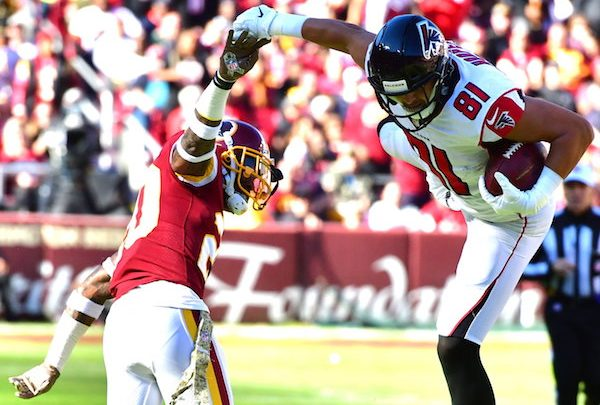 Atlanta Falcons tight end Austin Hoopaer goes airborne to make a reception while defended by Washington Redskins safety Ha Ha Clinton-Dix during Atlanta's 38-14 win at FedEx Field in Landover, Md., on Nov. 4. (John E. De Freitas/The Washington Informer)