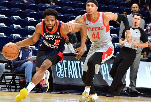 Capital City Go Go guard Chasson Randle drives past Rio Grande Valley Vipers guard Brandon Sampson during the Vipers' 111-101 win at St. Elizabeths East Entertainment and Sports Arena in D.C. on Nov. 11. (John E. De Freitas/The Washington Informer)