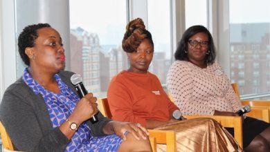 Businesswomen engage in conversation. (Brigette Squire/The Washington Informer)
