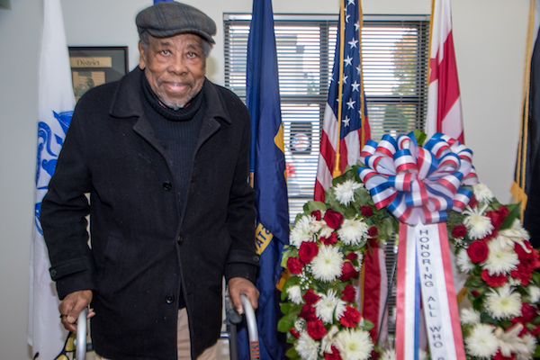 John N. Miller, 95, a resident at Access Housing, Inc., DC, a housing facility in Southeast for homeless veterans, spent Veterans Day with friends reminiscing over their days of military service. (Shevry Lassiter/The Washington Informer)