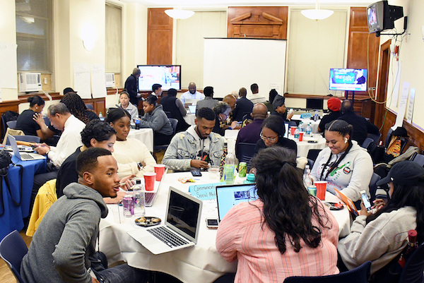 Students from Howard University and others schools in the D.C. area participate in the Get Out the Vote campaign as part of National Coalition on Black Civic Participation and the Ronald W. Walters Leadership & Policy Center in Northwest on Nov. 6. (Roy Lewis/The Washington Informer)