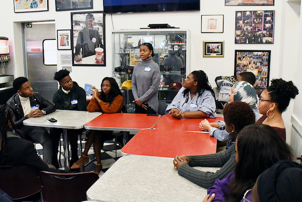 Lauryn Renford, student spokesperson for Thurgood Marshall Academy, shares why she and her classmates produced a Stop the Violence video at Ben's Chili Bowl in northwest D.C. on Nov. 8. (Roy Lewis/The Washington Informer)
