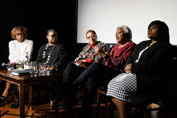 Political analyst Donna Brazile (second from right) tells stories about her election night TV appearances during a post-election panel discussion at Busboys and Poets in Northeast on Nov. 7. The panelists were (from left) Yolanda Caraway, Rev. Leah Daughtry, panel moderator Julianne Malveaux, Brazile and Minyon Moore. (Roy Lewis/The Washington Informer)