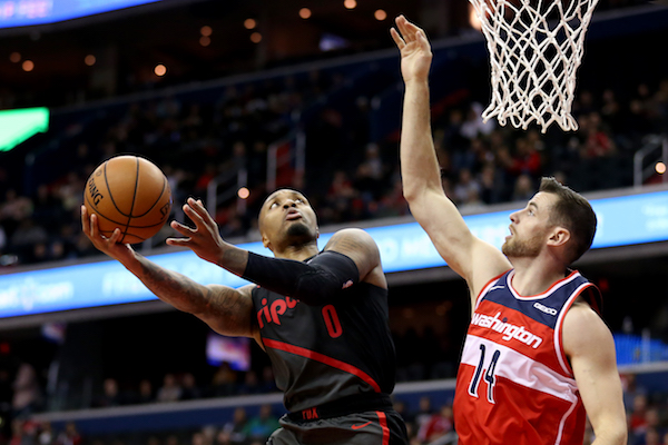 Damian Lillard #0 of the Portland Trail Blazers shoots against Jason Smith #14 of the Washington Wizards during the second half at Capital One Arena on November 18, 2018 in Washington, DC. (Photo by Will Newton/Getty Images)