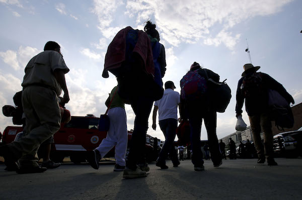 Central American migrants moving in a caravan towards the United States head to a shelter in the outskirts of Zapotlanejo, Jalisco state, Mexico, on Nov. 11, 2018. (Photo by Ulises Ruiz/AFP/Getty Images)