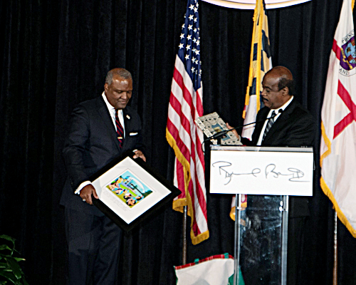 Montgomery County Executive Isiah Leggett (at podium) celebrates the birthday and farewell celebration for Prince George's County Executive Rushern L. Baker III (left) at the Camelot by Martin's in Upper Marlboro on Nov. 19. (Shevry Lassiter/The Washington Informer)