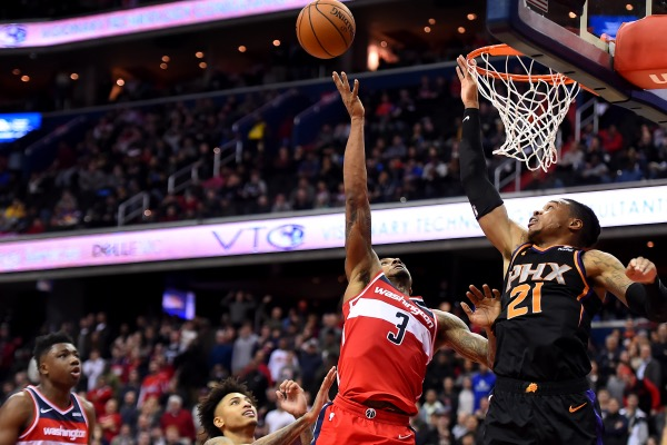 Bradley Beal #3 of the Washington Wizards makes a shot over Richaun Holmes #21 of the Phoenix Suns during overtime at Capital One Arena on December 22, 2018 in Washington, DC. (Photo by Will Newton/Getty Images)
