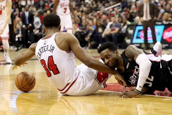 Chicago Bulls forward Wendell Carter Jr. (left) and Washington Wizards forward Jeff Green go after a loose ball in the second half of the Bulls' 101-92 win at Capital One Arena in D.C. on Dec. 28. (Rob Carr/Getty Images)