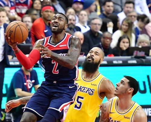 Washington Wizards guard John Wall drives to the basket during the Wizards' 128-110 victory over the Los Angeles Lakers at Capital One Arena in D.C. on Dec. 16. (John De Freitas/The Washington Informer)