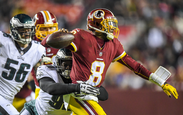 Washington Redskins quarterback Josh Johnson (8) is wrapped up by Philadelphia Eagles defensive tackle Treyvon Hester (90) in the third quarter of the Eagles' 24-0 win at FedEx Field in D.C. on Dec. 30. (Photo by Jonathan Newton/The Washington Post via Getty Images)